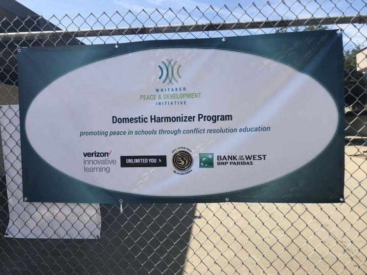 A banner supporting WPDI's Domestic Harmonizer Program