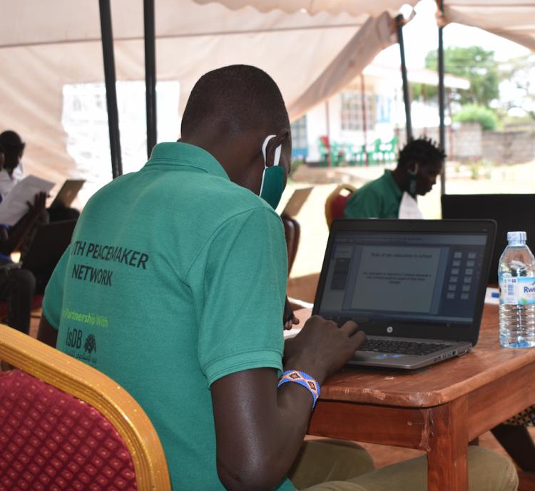 A youth training to become a WPDI Youth Peacemaker in Karamoja, Uganda