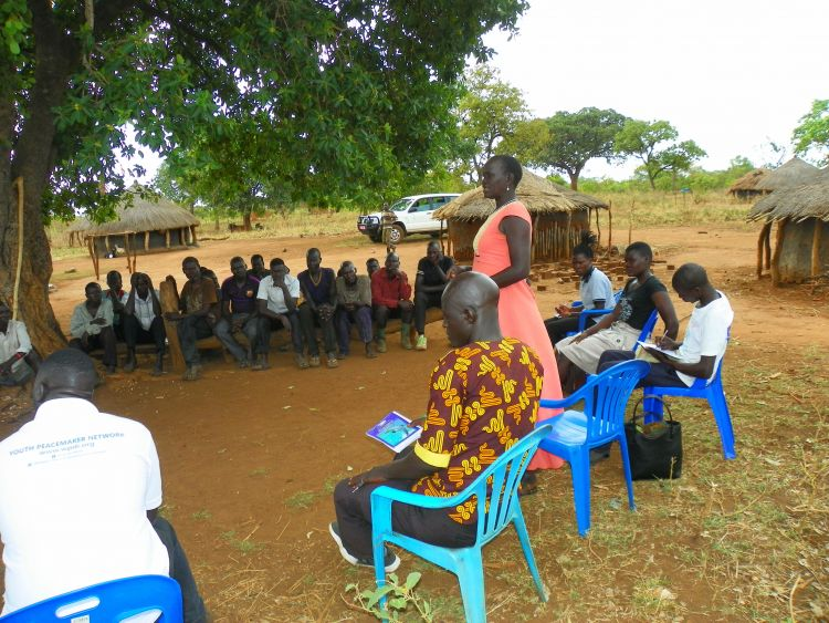Speaking out at a Community Dialogue