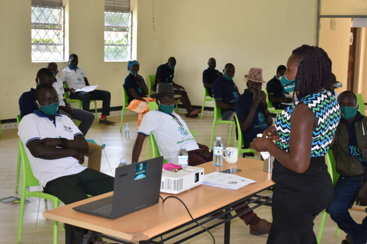 Community leaders learning about Conflict Resolution from WPDI in Karamoja, Uganda