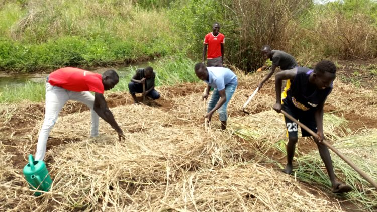 WPDI youth helping a business in South Sudan