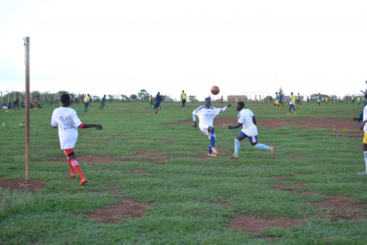 Youth playing soccer in the Whitaker Peace Cup