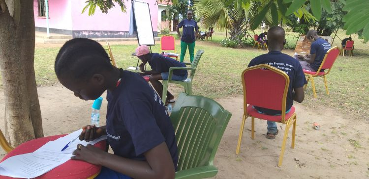 Youth in South Sudan taking a final assessment for WPDI